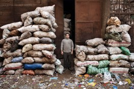 A glass collector infront of his factory in Zabbaleen's area. They recycling the 80% of the rubbish they collect.