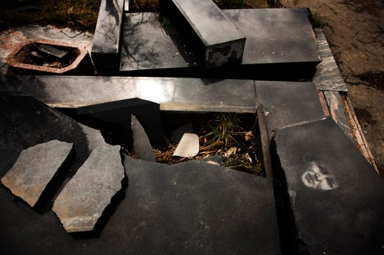 A desecrated grave in a Serbian cemetary on the south bank of Mitrovica, Kosovo.