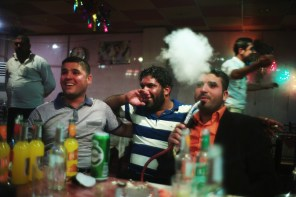 Baghdad's Lower East side. Men drink alcohol, smoke nargileh and watch belly dancers in Abu Nuwass. Baghdad's Lower East Side, Abu Nuwass is a riverside tree-lined street of seedy liquor-serving nightclubs and, fish restaurants and alcohol. Business is booming.
