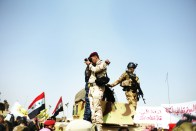 Iraqi Military photograph demonstrators. Ramadi, IRAQ: An Iraqi military policemen photographed demonstrators during anti-government demonstration in Iraq's Anbar province. Once occupied by American troops, the country today looks increasingly occupied by an authoritarian Iraqi military.