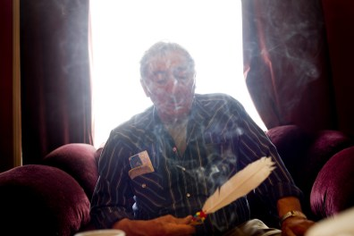 Louie Ladouceur, referred to by some of his friends as a medicine man, carries out a traditional smudge, using sage and an eagle feather, in Fort Chipewyan.