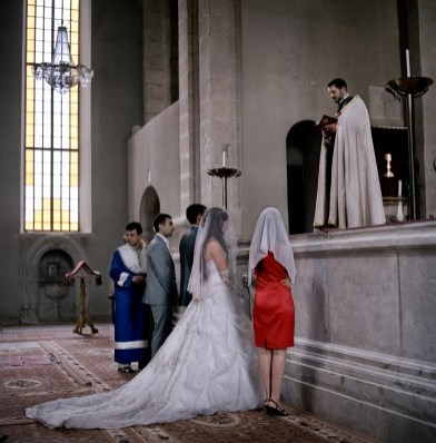 """Father Andreas marries Ara Avagimyan and Elita Khachaturyan at Ghazanchetsots church in Shushi, Nagorno Karabakh on the 22nd July 2011. The young couple will receive a wedding payment of approximately €575 (300,00 ad) as part of the government's """"Birth Encouragement Program""""."""
