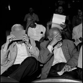 Former military men, hide their faces to the photographer during a session of their trial in which they are being acused by the Argentine state of crimes against the Humanity in the last dictatorship from 1976-1983. Bahia Blanca, Argentina, February 2012.