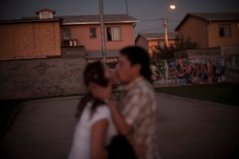 A young couple kisses in the street. In private, the girl suffers from gender violencia