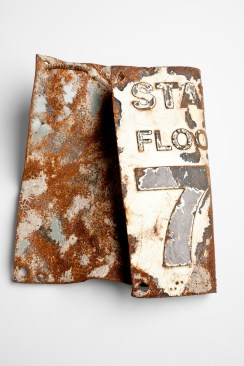 A floor sign from the 78th floor of one of the twin towers. This item was recovered from Ground Zero post 9/11.
