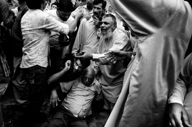 Karachi, Pakistan, September 2010: A man injured by gunmen by mistake while he was passing on the road during the target killing of two journalists in Saddar.
