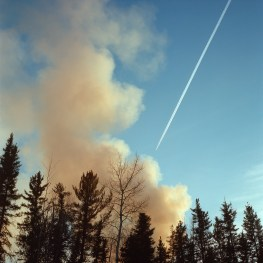 Smoke rises from a brush fire in Fort McKay.