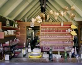 """The bar of the """"Valle Verde"""" restaurant as it was left some years ago due to the closing of its ski facility in Sella Chianzutan, Verzegnis (UD). During the past ten years, Promotur, the regional ski facility concessionaire, has been abandoning what it called the """"Minor Hubs"""" investing only on the major ones like the Zoncolan or the Lussari. ------------------------------------------------- Il bar del ristorante """"Valle Verde"""" presso gli impianti di risalita di Sella Chianzutan, Verzegnis UD. I tre SL di Sella Chianzutan facevano parte dei cosiddetti """"Poli minori"""" della Promotur. Dopo che l'asta del comune di Verzegnis per l'assegnazione della gestione di impianti di risalita e albergo annesso è andata deserta, le speranze di rivedere Sella Chianzutan rianimarsi di sciatori sono vane. Nel corso degli ultimi dieci anni la Promotur, operatore unico degli impianti di risalita del FVG, ha progressivamente abbandonato i """"poli minori"""" - secondo la dicitura dei depliant della Promotur - preferendo investire in stazioni piu grandi come lo Zoncolan o il Lussari."""
