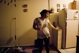 Yasmin is drunk and dances in her house.
