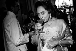 Jewelle Taylor Gibbs takes a sip from her cocktail during a gala to celebrate the first anniversary of the Museum of the African Diaspora at San Francisco City Hall.