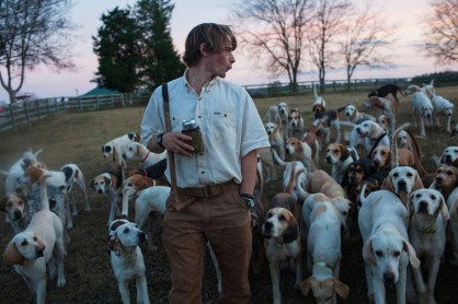 """Steve """"Spud"""" Evely calls the dogs after """"cocktail hour"""" where the dogs are allowed to socialize the night before a hunt at Hard Away Whitworth Hunt Club in Greensboro, Alabama on December 8, 2012."""