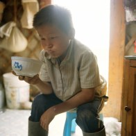 Mongolia, Gobi, Omongovi, 2012 Munkhdul is resting while drinking camel milk tea