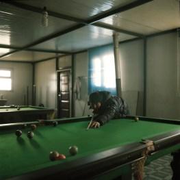 Mongolia, Gobi, White Mountain outpost , 2013 A miner playing pool