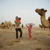 Mongolia, Gobi, Omongovi, 2012 Tuvshinbayar with his children during a sand storm