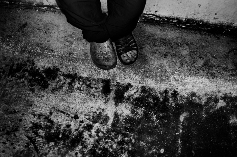 Matchless shoes on ruined floor