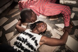 A junior pastor Fred Emanuel Gogo is dispossessing a woman from Tamale, the north of Ghana. Demonic powers are believed to have a strong and destructive influence on various facets of the believer's life. In this instance the exorcism includes calling on, the name of Jesus and, the power of the Holy Spirit and, using water and olive oil.