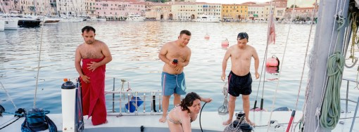 (L-R) Francesco, Emanuele, Cristiana and Matteo take a shower in the port of Porto Ferraio, Elba Island, Italy, 2012. Since 2006, Rome's branch of the Italian Association of People with Down syndrome is running a sailing program for young adults. Rather than being a sailing school, the program uses the boat environment to challenge the adaptive skills of its participants. In 2012 a group of the eight most proficient users were selected to join up with the official team of Mascalzone Latino to participate, on board of La Poste as a mixed crew, for the historical Barcolana sailing race. La Poste scored and amazing 24th position among more than 1000 participants.