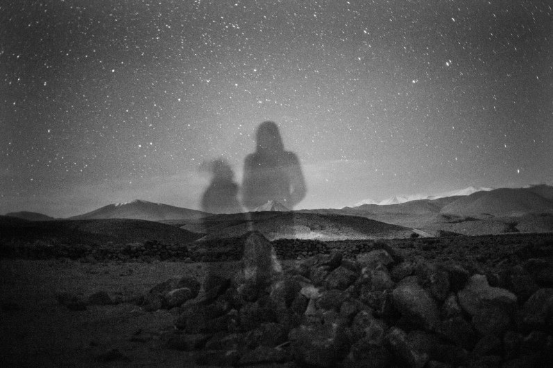 Self Portrait with Atacama Volcanoes by night in a plain in the middle of the desert, on the way to Tatio. The volcanoes of the horizon are known by the desert habitants like a big sleeping giant, because it's shape remember them to that.
