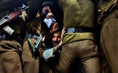 SRINAGAR, KASHMIR,INDIA, MARCH 20, 2004:A Kashmiri man sits inside a police van after he was arrested by Jammu and Kashmir police for protesting with the Association of Parents of Disappeared Persons (APDP) in Srinagar, the summer capital of Indian held Jammu and Kashmir state in India, March 20, 2004. At least a dozen people were wounded when police used batons to disperse hundreds of protestors. APDP says more than six thousand people have gone missing since the bloody revolt erupted in Kashmir.