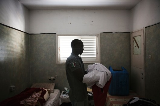 """Ahmed Dahiya, 29, is packing to go to Holot detention center. """"I have no idea what the future holds for me, one thing I am certain of, is that if I return to Sudan, I face life in prison or death."""" Ahmed escaped military service in Sudan. """" They wanted me to fight my own people and when I refused and they detained me and tortured me, and then I escaped. Going back to Sudan is not an option for me."""""""