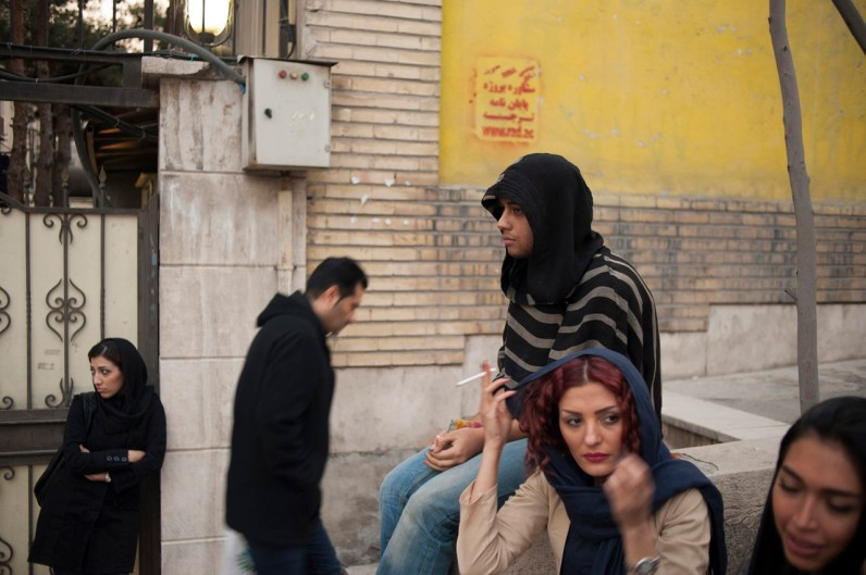 TEHRAN, IRAN: Amir and his classmates hang out on the side of street in between two critique sessions on the last day of school. Amir was the only boy in his class, studying fashion design at the Tehran Institute of Technology. In the coming months, just before finishing his fashion design degree, Amir will flee Iran to seek asylum in Turkey because of his homosexuality.