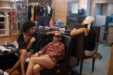 TEHRAN, IRAN - Shahin and Amir chill out at a private boutique in Northern Tehran waiting for Amir to finish his tanning sessions. As they live an abnormal and no accepted life style, most of their lives happen after hours and underground.