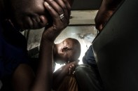 Exhausted workers, rest on the train ride back to the township