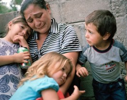 Lizeth Cerros mourns her murdered husband, Darwin Franco, with her children, later she received another death threat. Franco was a community organizer. (Dominic Bracco II / Prime for Pulitzer Center on Crisis Reporting)