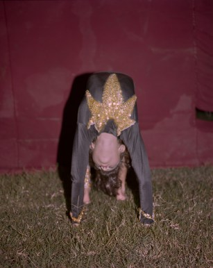 A young contortionist at the circus visiting San Pedro Sula. (Dominic Bracco II / Prime for Pulitzer Center on Crisis Reporting)