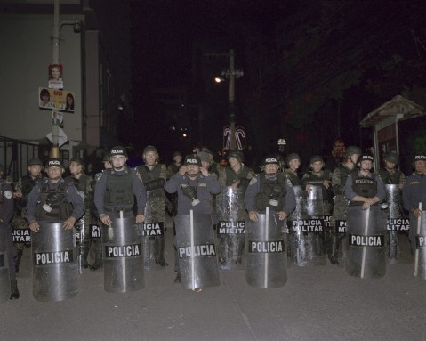 Riot Police wait for protesters to leave. (Dominic Bracco II / Prime for Pulitzer Center on Crisis Reporting)