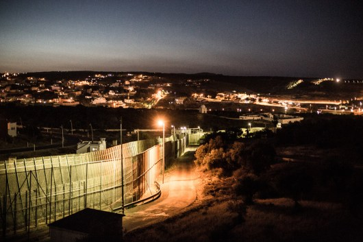 The three rows of fence between Morocco and the Spanish exclave Melilla seen from the Spanish side, Melilla, Spain, June 7, 2014. Thousands of migrants from sub-Saharan Africa wait on the hill for their chance to cross the three rows of fences towards Melilla and thus making it to the European Union. Spanish authorities recently ramped up security measures and announced that it will spend 2,1 Million Euros to fortify the border between Morocco and Melilla and Ceuta, the other Spanish exclave in the North African country.