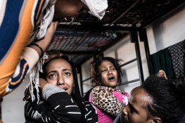 Jawaher, a 17-year-old Eritrean migrant, reacts to news of her mother's death, Subrata, Libya, April 14, 2014. Two nights earlier, Jawaher and her mother tried to cross the Mediterranean on smuggler's boat. When the police showed up, the group they were with was split. Jawaher's mother drowned when trying to get on one of the boats. The police later found her dead body on the beach. Jawaher was arrested by the police. After the revolution, Libya has become the major launching point for irregular migrants to cross the Mediterranean. In the first three month of 2014, the Italian Coast Guard intercepted 15,000 people on the Mediterranean, compared to 750 in the same time last year.