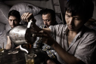 Afghan refugees have a tea brake in an underground textile factory in Istanbul, Turkey, May 14, 2012. All the workers here are Afghan refugees. They make 70 Turkish Lira (40 USD) a week working more than 60 hours. Many of them safe money for traffickers to take them to Greece over the river Evros. The traffickers take between 600 and 2000 US Dollars. The land border between the two countries has become the main illegal entry point for refugees going to Europe according to Frontex, the European Union's border policing agency. In 2011 that amounted to more than 55,000 people who were detected, a 17 percent rise from the year before.