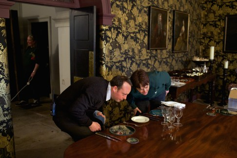 From the new book A Place in the Country. Holkham Estate. North Norfolk. Laying the Chinese Room table for a formal dinner. Glasses are lined up by eye and the laying can take hours.