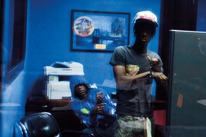Defendants at a bail bond office, waiting to be returned to jail in Brooklyn, NYC, 2013.