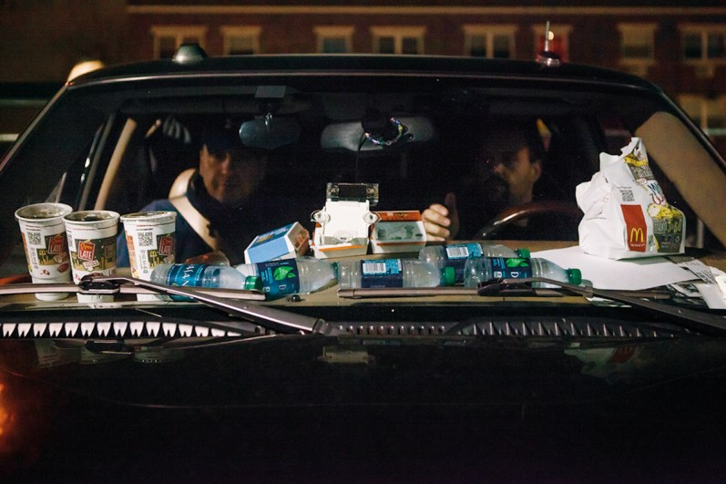 Bondsmen during a stakeout that could last all night. Buswick, Brooklyn, NYC, 2013.