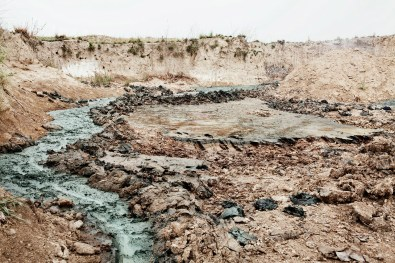 Chemical spills from one of the tanneries of Kanpur, pour into the Ganges, India 2012.