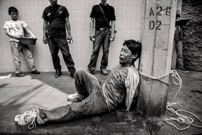Raul Rivas, delinquent tied in a central street of San Pedro Sula is subsequently died from drug intoxication. Honduras, August 2014