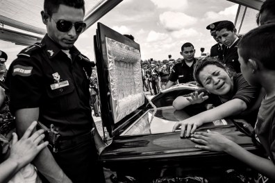 Funeral at the municipal cemetery of El Progreso Police Officer Alex Alvarez Gomez Cecilio killed by gang members. Honduras in August 2014