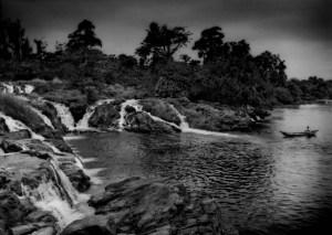 Chutes de la Lobe waterfall along Cameroon's wild southern coast is one of the few waterfalls that empty into the sea. Near Kribi, Cameroon.