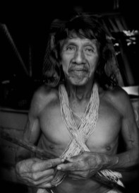 """""""Afectado"""" (Affected One): Davo Enemenga, a Huaorani man whose ancestral land has been contaminated by oil exploration by Chinese government-owned, Petro Oriental. """"They promised to help us (the local Huaorani residents) and and did not, says Enomenga. They caused us problems. They paid us nothing, no cash (his word, """"silver"""" coins or cash). They cheated us"""". Proveta, south of Coca, Ecuador. According to the company website, """"PetroOriental S.A. are companies established through capital provided by state-run firms from the People's Republic of China. These include: China National Petroleum Corporation (CNPC) with 55% shareholder participation and China Petrochemical Corporation (SINOPEC) with 45% shareholder participation."""""""