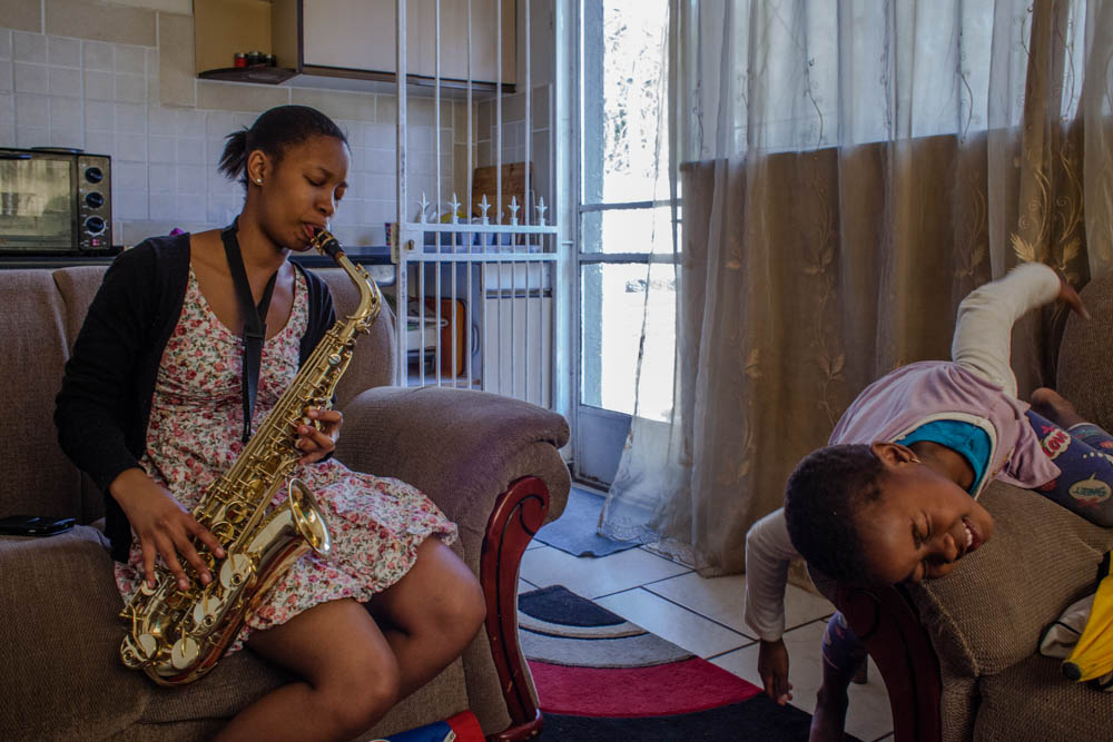 Nonkuliseko playing a saxophone at her house in Johannesburg. 2014