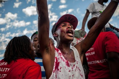 A student applauding to the crowd watching the removal of the statue of Cecil John Rhodes. 2015
