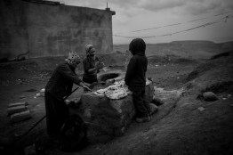 Iraq - Zakho, Yazidi refugees from Shingal / Sinjar Mountains, at the Syrian-Iraqi border,  live in Zakho, everywhere where the eye drops. In unfinished incomplete houses, in camps, on streets. They have little to eat, no winter clothing, no medication. Yezidi women bake traditional bread.