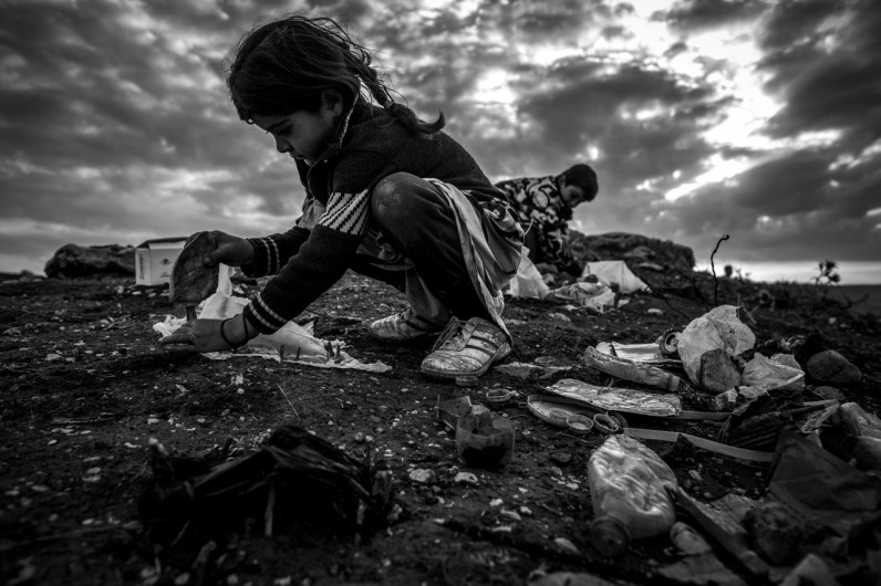 Iraq Sinjar Mountains. The humanitarian situation of the refugees is very bad. Children build model tents from garbage, they have no toys.