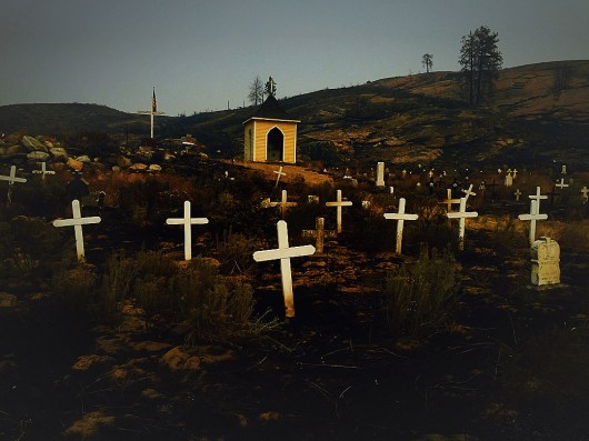 Day 6: Wildfire ran through the old cemetery at St. Mary's Mission burning grass and sagebrush. Colville Indian Reservation. Near Omak, WA.