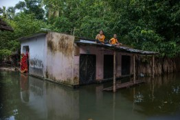 A family trapped by the flood water at Tala in Satkhira.