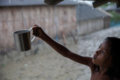 Rani, 9, collects rainwater for drinking. Rainwater is the main source of drinking water in the village of Shyamnagar.