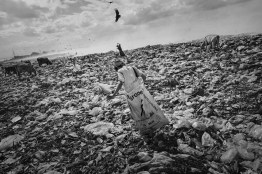 """Nicaragua, Managua city, may 2011.The gratest landfill in Central America so named """"Chureca"""", Rigoberto Ernandez, 11 years old. He started to work in the landfill at 8 years old with his mother and his sister. Thousands of children working here, along with their families but often, the recycling activities within the landfill, involving children living on the streets without family and trying to get their daily sustenance."""