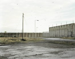 """""""It was my second shoot at the former Maze Prison in Northern Ireland, and I hadn't a clue how to photograph it; what camera, what approach.... I was lost, and at that time, completely insecure about my own practice... Could I ever find my own voice, make something that could be actually good? On a winter morning, alone in the 360-acre prison site (ready for new prisoners in case the Peace Process collapsed), standing with a 5 x 4 inch plate camera that I had bought for virtually nothing in a bomb-damaged sale in Belfast when I was 14, I set up the camera and focused my head under the cloth, and realised, I was in the place where the bomber mostly likely had spent a lot of time."""" — Donovan Wylie"""